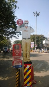 police man dummy on road