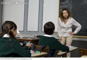 Teacher scolding a young student in class
