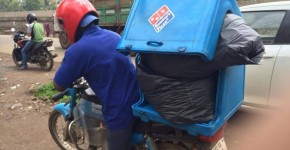 dominos carry garbage